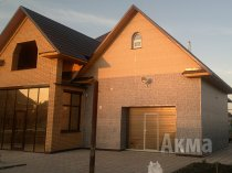 Фасадні панелі для зовнішньої обробки будинку в Новосибірську