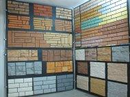 Обробити фасад штучним каменем